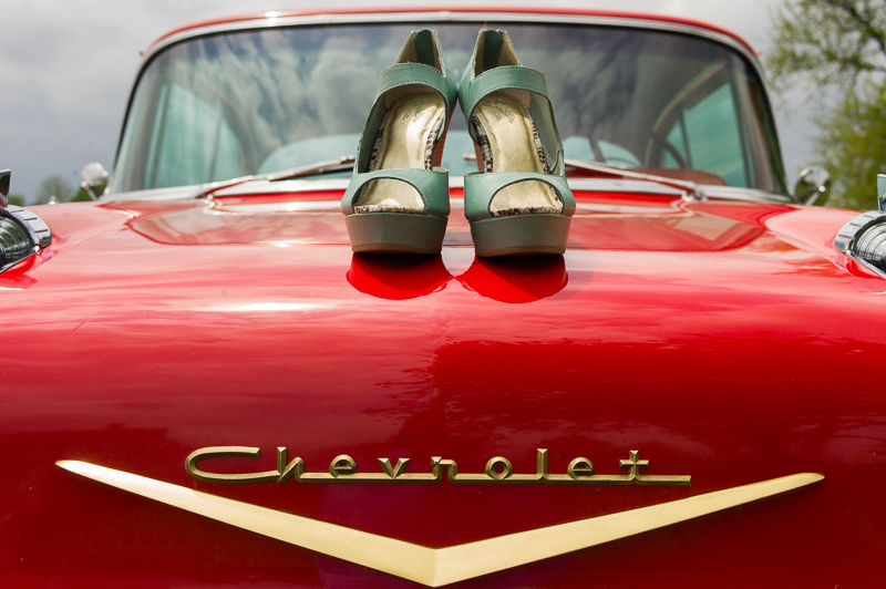 classic car 1957 chevy with wedding shoes