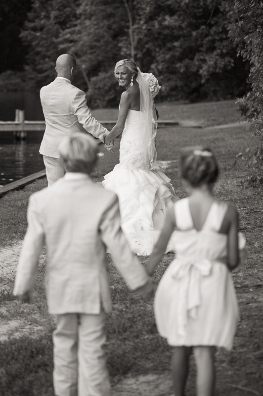 bride and groom with flower and ring bearer